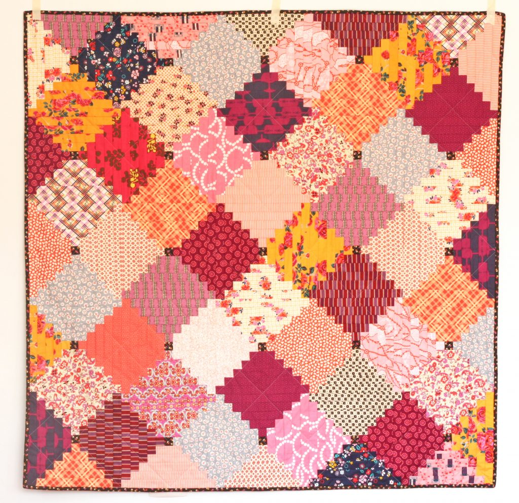 Courthouse Steps quilt in orange and pink