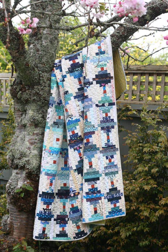 Scrappy Courthouse Steps quilt in blue and white by Wooden Spoon Quilts